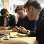 Students examine historic artefacts