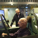 ATA veteran flies our Spitfire simulator watched by his son Anthony