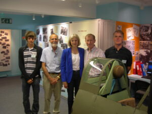 After her Spitfire simulator flight Theresa and Philip May pose with Heritage Centre volunteers